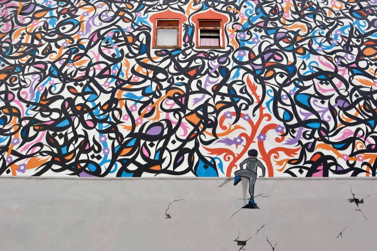 Tre street artist colorano Tor Bella Monaca